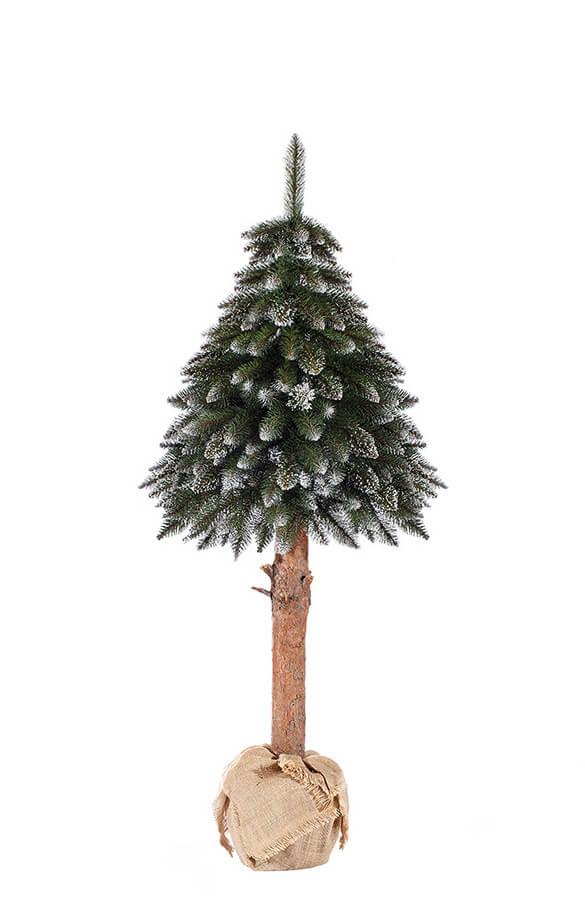Arbre de Noël artificiel épicéa enneigé sur le tronc