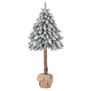 Arbre de Noël artificiel épicéa sur le tronc avec la neige