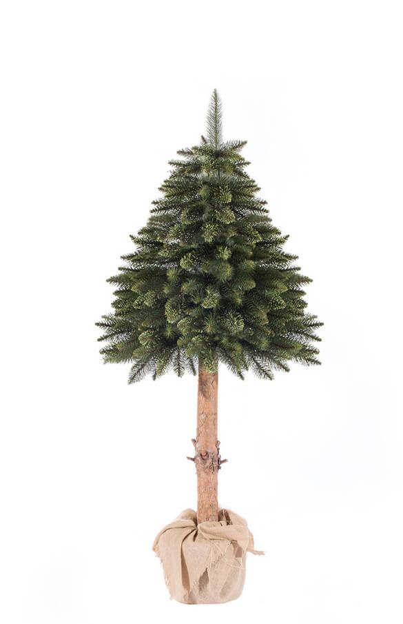 Arbre de Noël artificiel épicéa vert sur le tronc